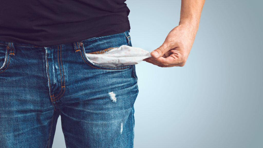 Man pulling out empty jeans pocket, repay Bounce Back Loan concept