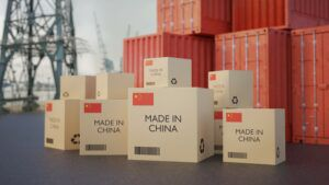Cardboard boxes stamped Made in China on dockside, import China concept