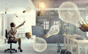 Young seated businesswoman reaching out to inspirational floating lightbulbs, best quotes entrepreneur concept