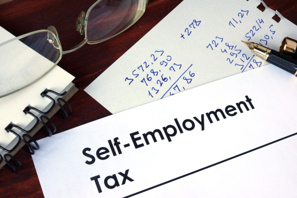 Self-Employment Tax form on desk, self-employed tax concept