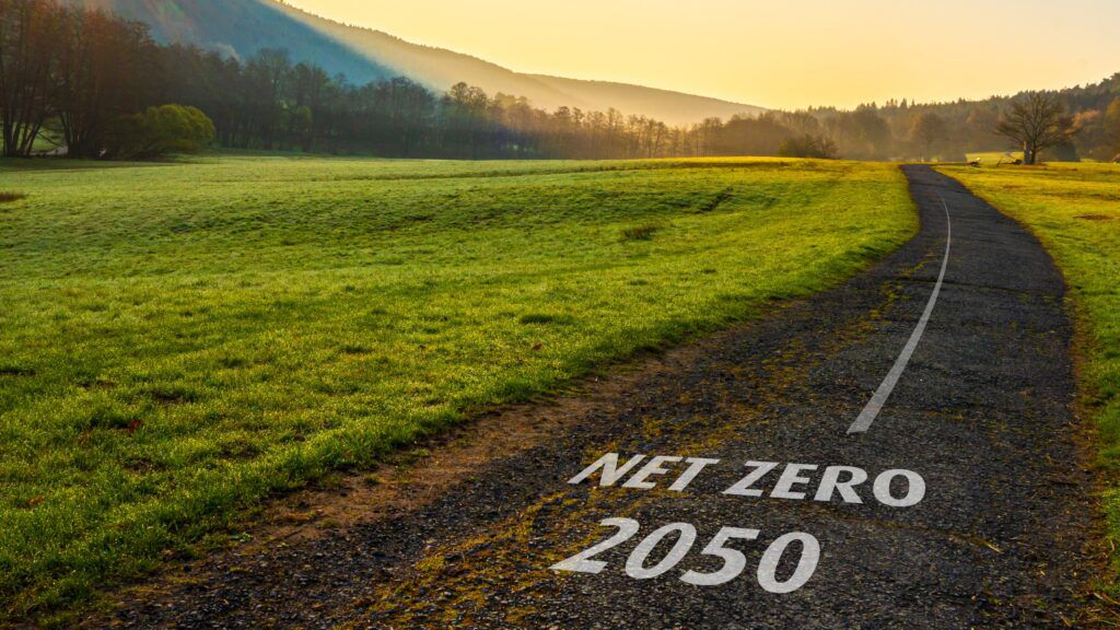 road with words 'net zero 2050' superimposed on it